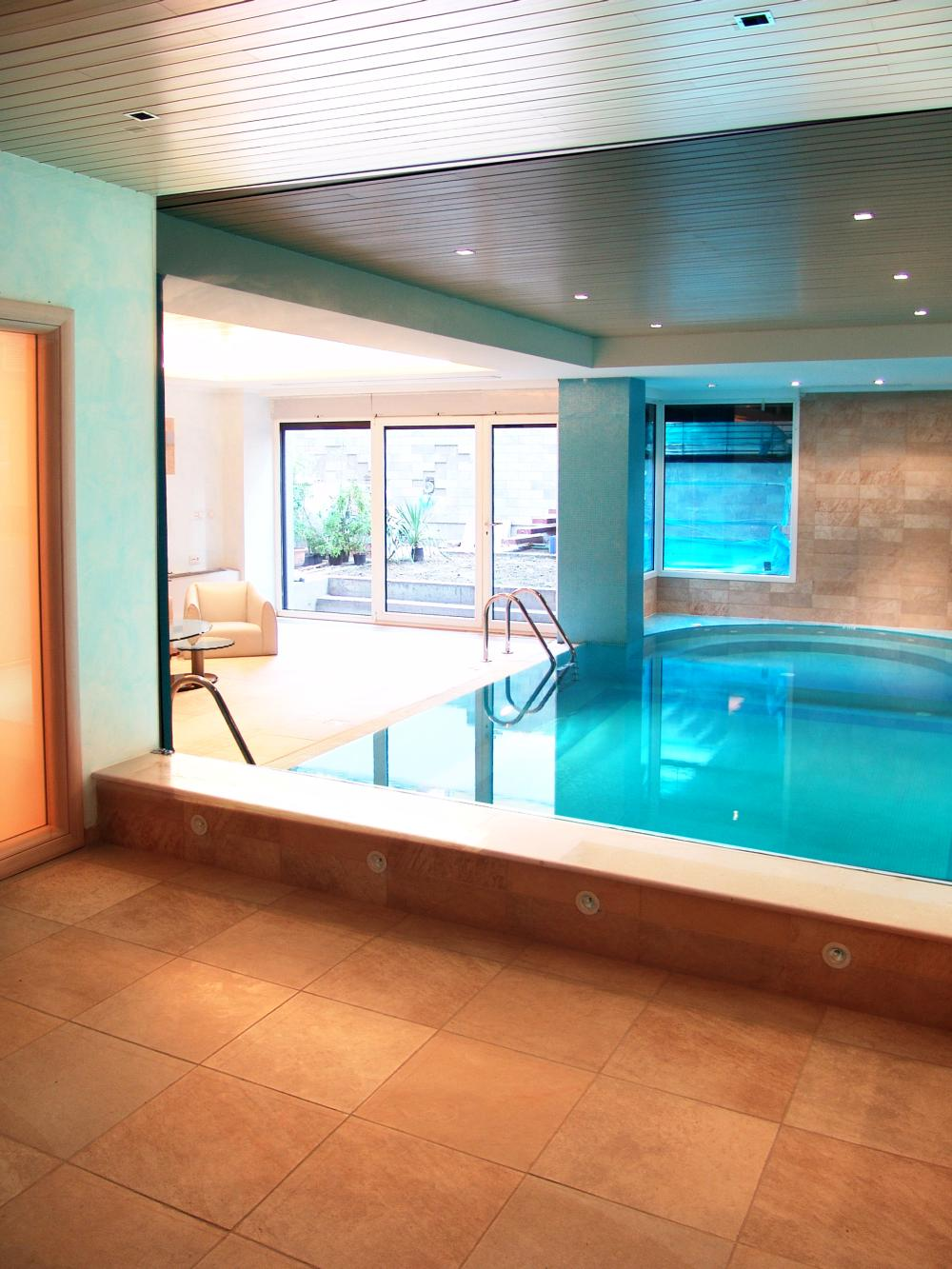 https://nbc-arhitect.ro/wp-content/uploads/2020/10/NBC-Arhitect-_-Cube-House-_-Bucharest-Romania-_-interior-view_swimming-pool.jpg